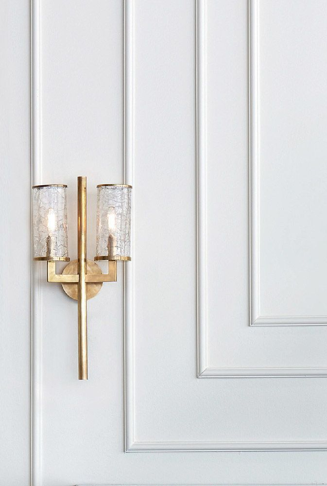 KELLY WEARSTLER | LIAISON DOUBLE SCONCE. A modernist light fixture featuring fractured glass and soulful architecture