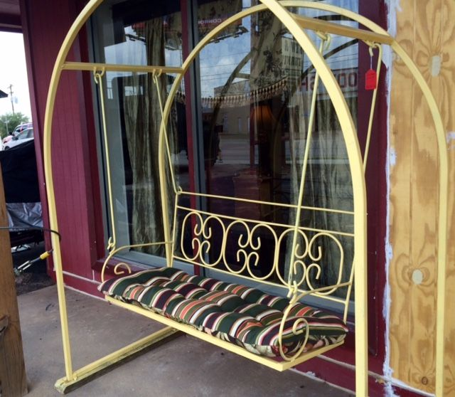 Wonderful vintage wrought iron swing perfect for the front porch.
