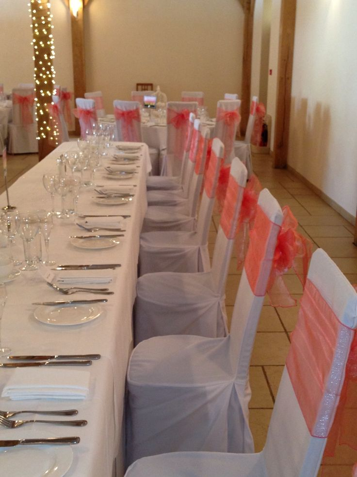 Coral Chair Bows On Bespoke Covers At Rivervale Barn Wedding Venue By