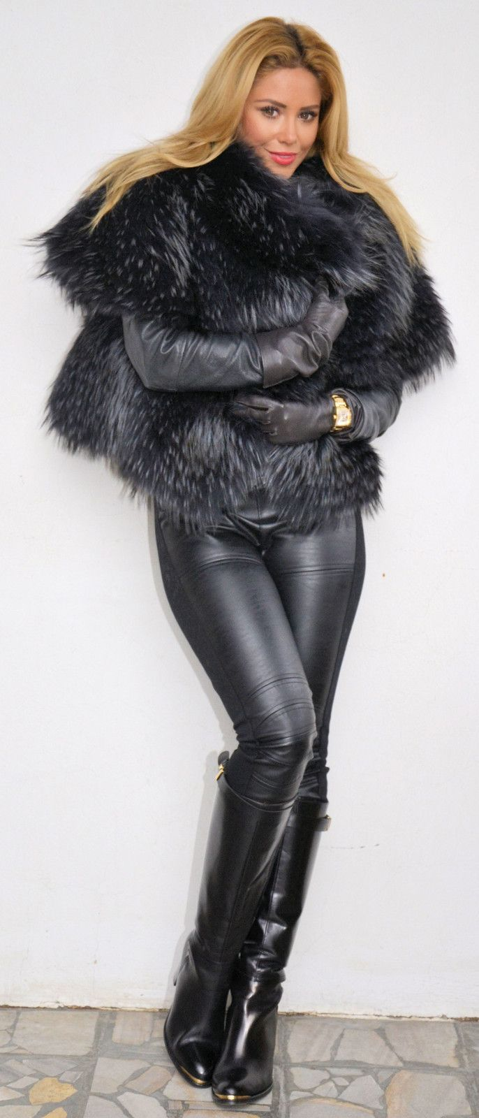 Beautiful blonde in fur and leather!