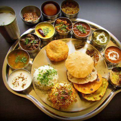 Thali-This is just dinner in India with various shaaks and breads. Indian food