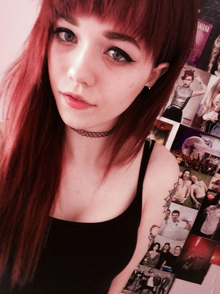 Red hair, full fringe, choker, tattoos, 10mm ear gauges