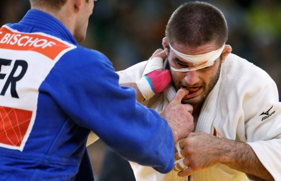 Men's Judo  Travis Stevens of the U.S., right, competes with Germany's Ole Bischof during the men's 81-kg judo competition at the London 2012 Olympic Games on July 31, 2012.