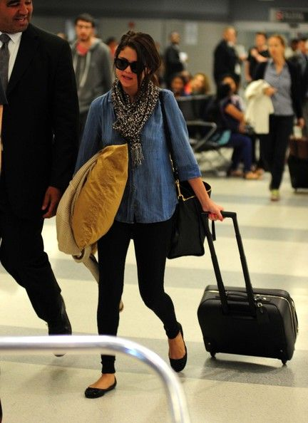 Selena Gomez arrives at the JFK airport in New York, NY on June 8, 2012. Brand: Bella Dahl