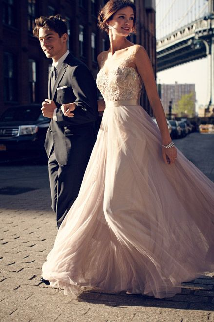 This pale pink gown is the kind of dress you could just get swept away in. So gorgeous!