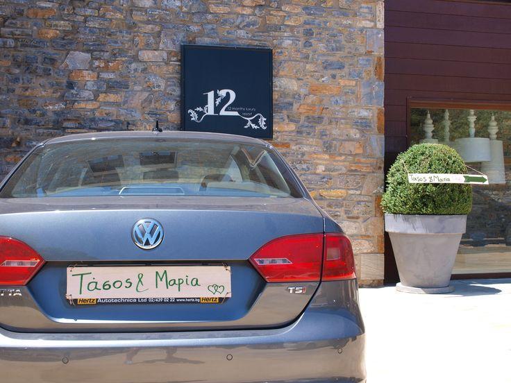 Groom & Bride's car in entrance of 12 luxury Resort