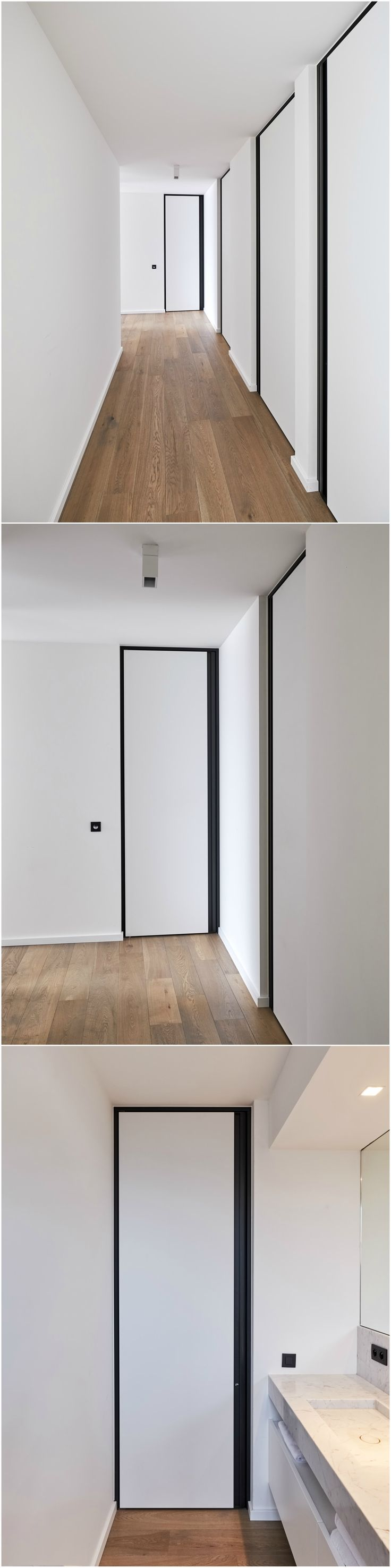 Moderne binnendeuren van vloer tot plafond met zwarte omlijstingen en zwarte verticale handgrepen, die volledig vlak met de deur ingewerkt zijn.