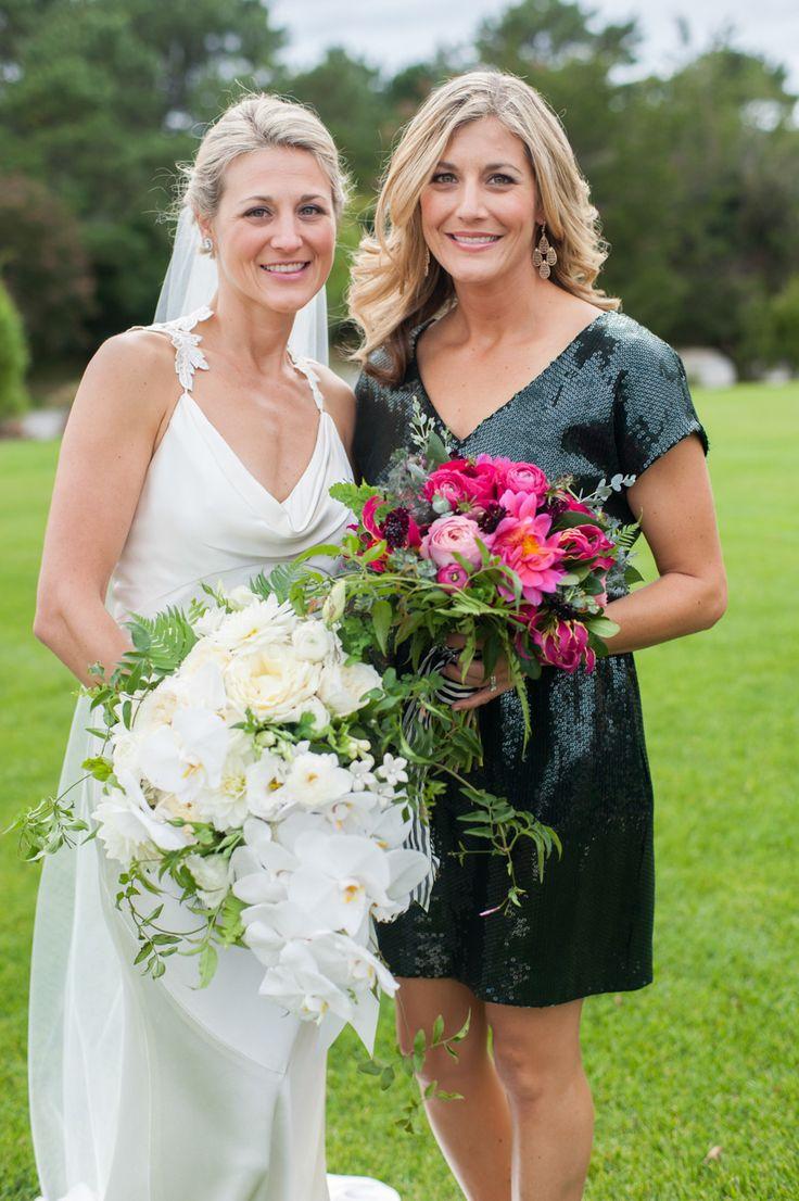 #stephanotis, #love, #garden-rose, #ranunculus, #orchid, #dahlia, #pink, #hot-pink, #dress, #fuchsia, #gloriosa-lily  Photography: Leila Brewster - leilabrewsterphotography.com Floral Design: Hana Floral Design - hanafloraldesign.com Wedding Dress: Elizabeth Filmore - www.elizabethfillmorebridal.com Bridesmaids' Dresses:  Various Black Dresses -  Various Black Dresses