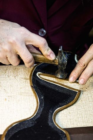 Folding the edges ...made by hand shoe