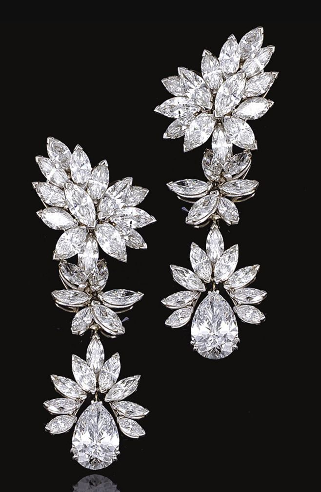 FINE PAIR OF DIAMOND PENDENT EARRINGS. Each composed of four detachable parts, set with clusters of marquise-shaped diamonds, terminating on a pear-shaped diamond drop weighing 3.86 and 4.49 carats respectively, mounted in platinum.