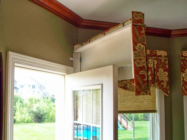 From The Workroom of Parkway Window Works. Finally, a solution to matching that door's window treatment to the nearby windows'. This is a fantastic article, which also has a section on arched rods that I've never seen before.