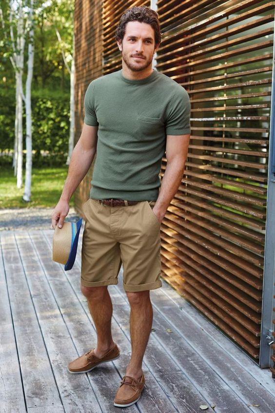 Shop this look on Lookastic:  https://lookastic.com/men/looks/crew-neck-t-shirt-shorts-boat-shoes-hat-belt/10109  — Olive Crew-neck T-shirt  — Dark Brown Woven Leather Belt  — Tan Straw Hat  — Tan Shorts  — Tan Leather Boat Shoes