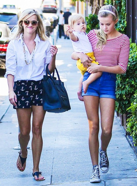 Reese Witherspoon in a white button-down and printed shorts with daughter Ava Phillippe in a striped top and denim shorts