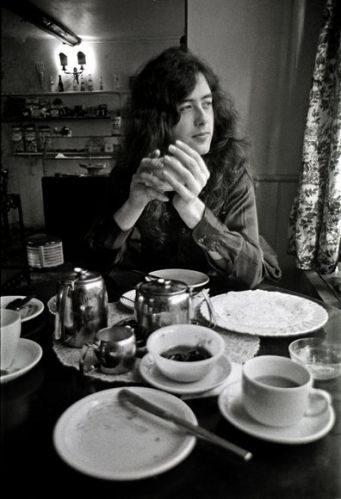 Jimmy Page photographed at his Pangbourne boathouse, in the English countryside, between tours in February 1970.