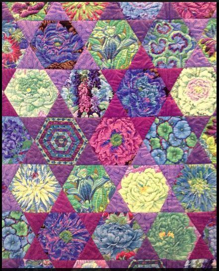 Wonderful use of Kaffe Fassett's fabrics and the hexagon and triangle design.