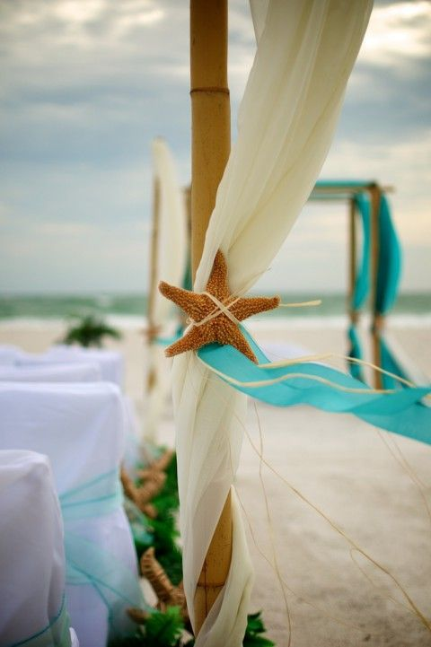 Turquoise beach wedding with starfish accents.