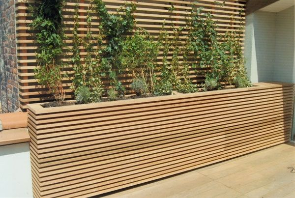 Love this modern patio planter box under deck wall for Deck garden box designs