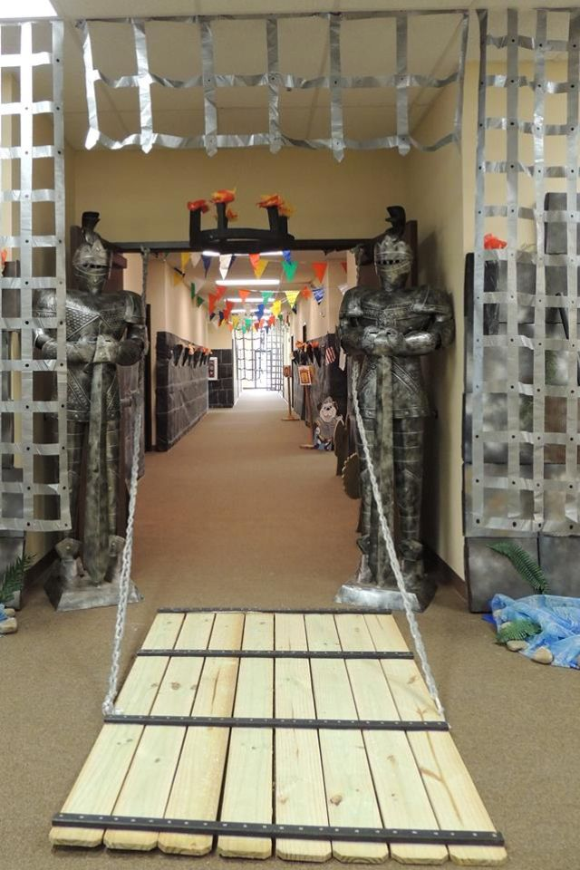 Wow! Foil portcullis and wooden drawbridge entrance for medieval party. Game of Thrones-esque!