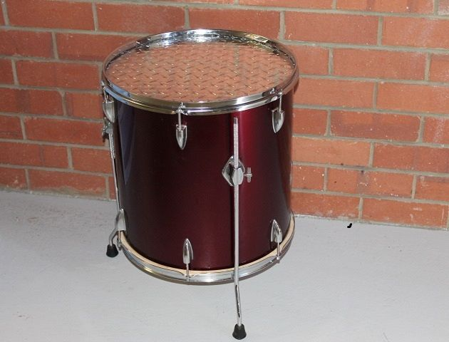 Coffee table drum. Shiny aluminium top. Looks great.