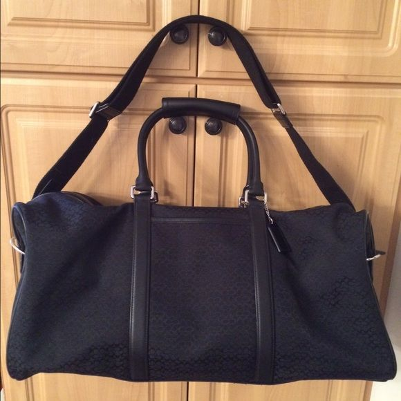 "Coach duffle bag Original ""c"" Coach duffle bag!! Excellent condition and makes a great travel piece! Coach Bags Travel Bags"