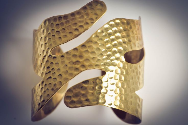 Cuff handmade from recycled bullets.  Available now at www.banteaysreyboutique.com