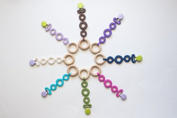Crochet clip on teething rings. Such a great idea, love these colors. These would make an awesome sling toy!  #baby #crochet #moderncrochet #teething #teether #organicbaby #teethingring #crochetteethingring #ecobaby #momtobe #babygift #babywearing