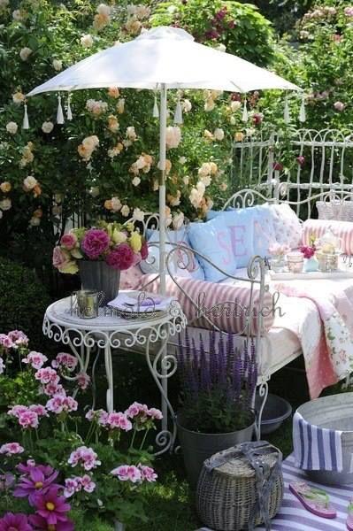 Beautiful bench, parasol & cushions in the garden  ~ lovingly repinned by www.skipperwoodhome.co.uk