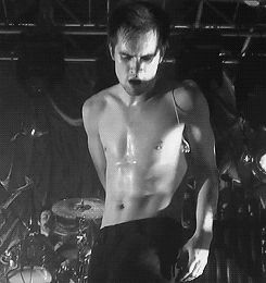 CLICK FOR GIF. Dancing, sweating, looking unbelievably sexy...just another day in the life of Brendon Urie #panic!atthedisco #brendonurie