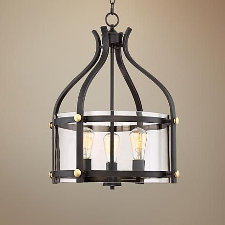 Update your foyer with this beautiful industrial-inspired bronze pendant light accented with gold details.