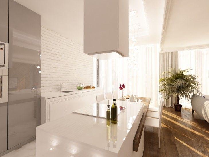 Biała klasyczna kuchnia, z nowoczesną wyspą pokrytą blatem z konglomeratu. Bryła wyspy została przecięta przez drewniany stół jadalniany.