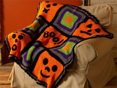 Crochet Pumpkin Face Throw. Provided by Coats & Clark and uses Red Heart Yarns. Designed by Michele Wilcox.