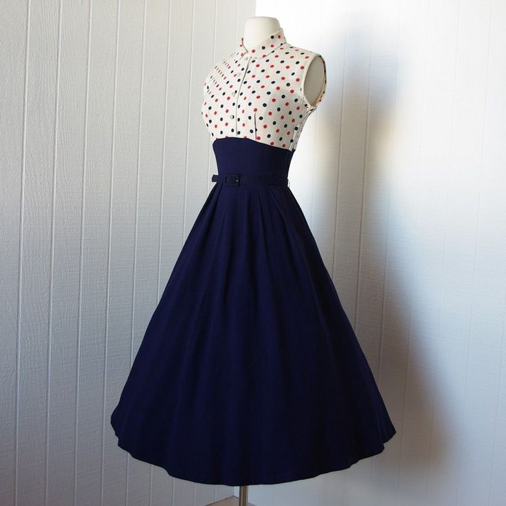 vintage 1940s dress …fabulous WWII navy blue full skirt pin-up dress with polka dot bodice and bolero jacket Image source