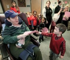 Day Nursery Association preschooler Evan Minicozzi give a valentine he made to Gino Merli Veterans Center resident Jim Uhl.    Read more: http://thetimes-tribune.com/news/toddlers-hand-deliver-valentines-to-veterans-1.1271514#ixzz1mN3EHoST