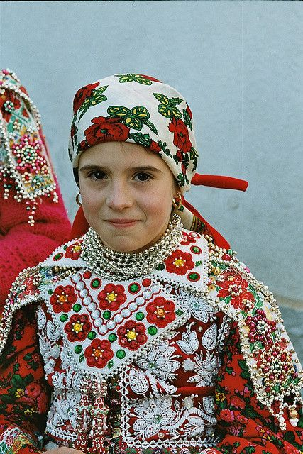 Europe | Portrait of a young girl wearing traditional clothes, Inaktelke, Romenia | Nicolaas Versteeg