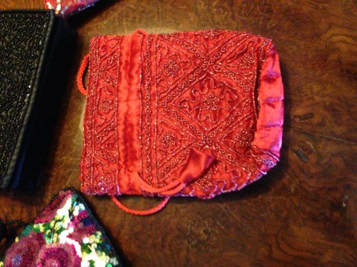 Luxurious red sachet in satin, beads and rhinestones