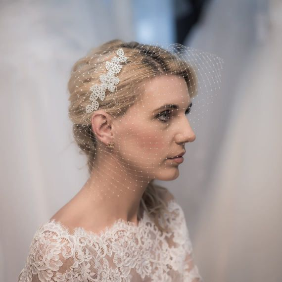 A hair piece with a face veil with sparkling crystals by AgencyART