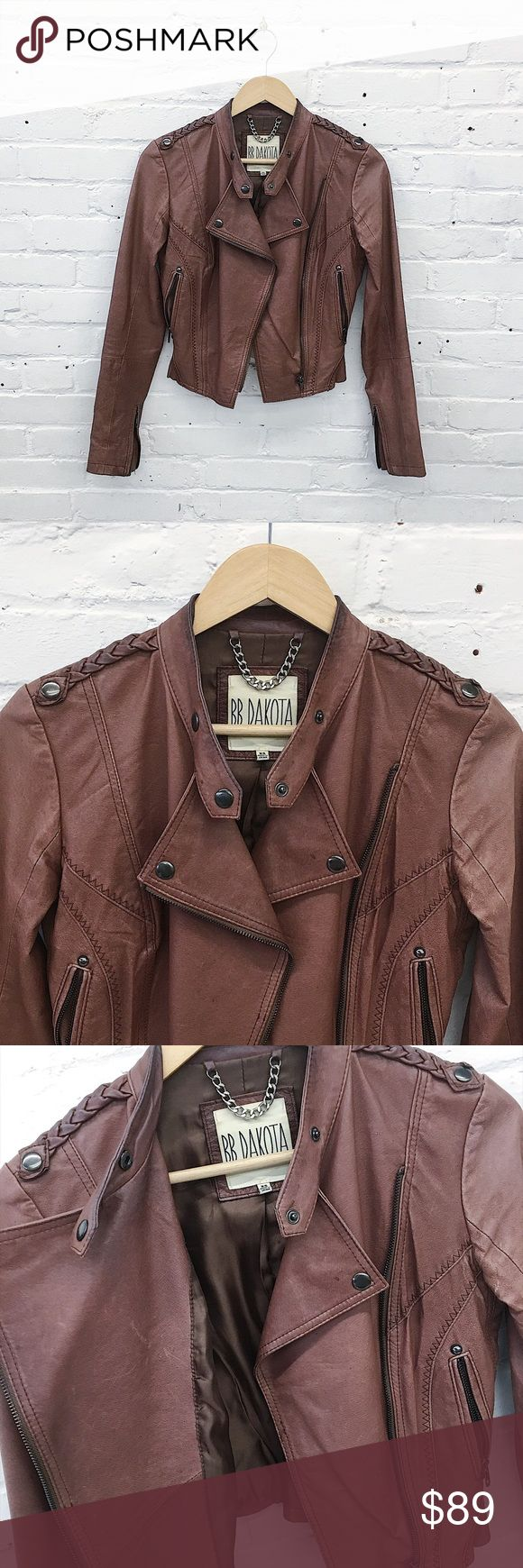 "BB Dakota Leather Jacket XS Totally rad genuine leather moto jacket from BB Dakota! Features fitted body with awesome braided epaulets, cool stitching, and hardware details. In excellent used condition with slight wear and patina to the leather. The leather is a warm reddish brown and super soft!  🔹Size XS - fits true 🔹Signs of wear (pictured)  🔹18"" length   🔹34"" bust  👉🏼 Want to negotiate? Please use the offer button. 👉🏼 Bundle with one more item for an instant 20% off! 👉🏼 Sorry…"