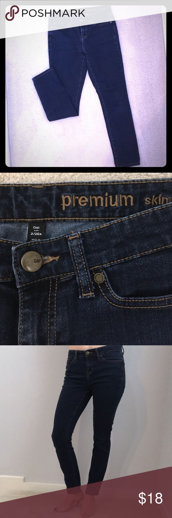 """Gap Size 2 Premium Skinny Jeans Dark Wash These dark skinny jeans are in great condition with no tears or stains. They are size 2 with a 26 inch waist and 27 inch inseam. These jeans are perfect for petite sizes, ladies under 5'4"""", or tall ladies looking for ankle-length jeans. They are stretchy, comfortable, and form fitting. 84% cotton, 15% polyester, and 1% spandex. Machine washable. GAP Jeans Skinny"""