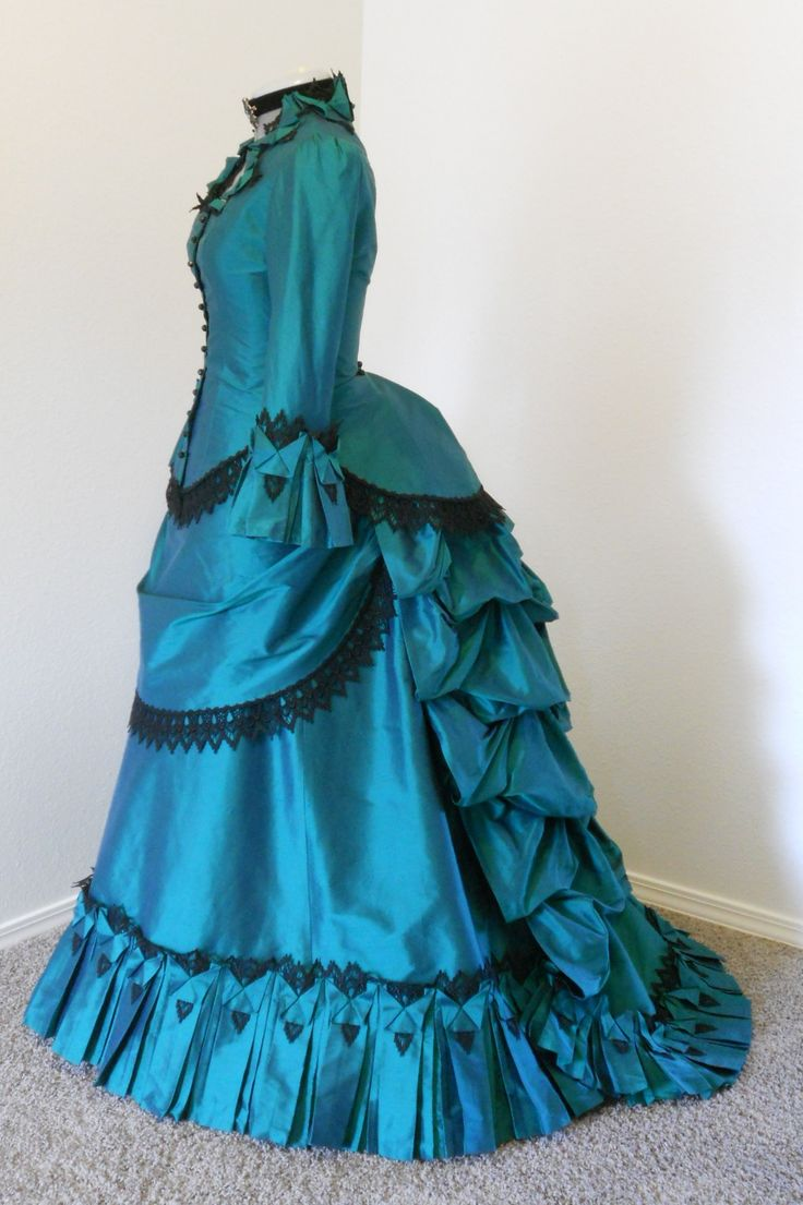 Victorian dress with once again the high neckline and the deep colors with lace detailing.