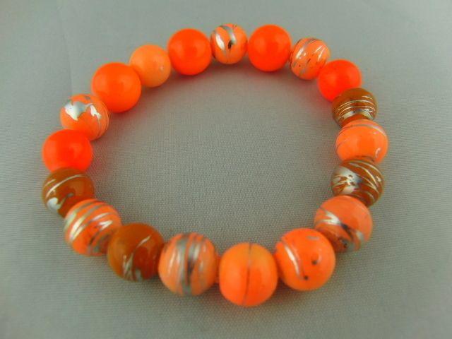 Stretch Beaded Bracelet Made Using Shades of Orange Beads Including Neon Orange  £6.00