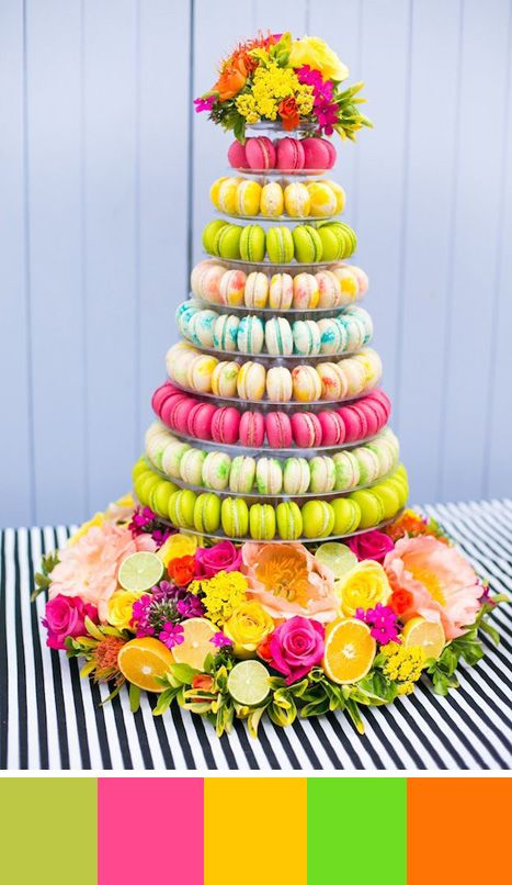 Rainbow theme macaroon cake -  perfect for a tropical wedding. Source: Bridal Musings #rainbowtheme #tropicalwedding #macarooncake
