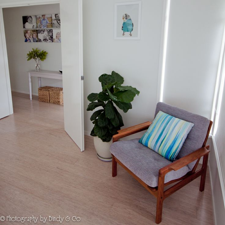 Refinished danish chair, fiddle leaf fig, limewashed bamboo flooring, hallway gallery, up cycled hall table.