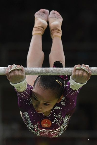 #RIO2016 China's Fan Yilin competes in the Uneven Bars event during the women's team final Artistic Gymnastics at the Olympic Arena during the Rio 2016...