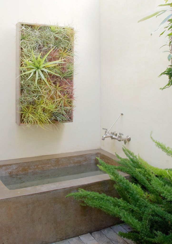 A gorgeous vertical planter that fits perfectly in this modern bathroom