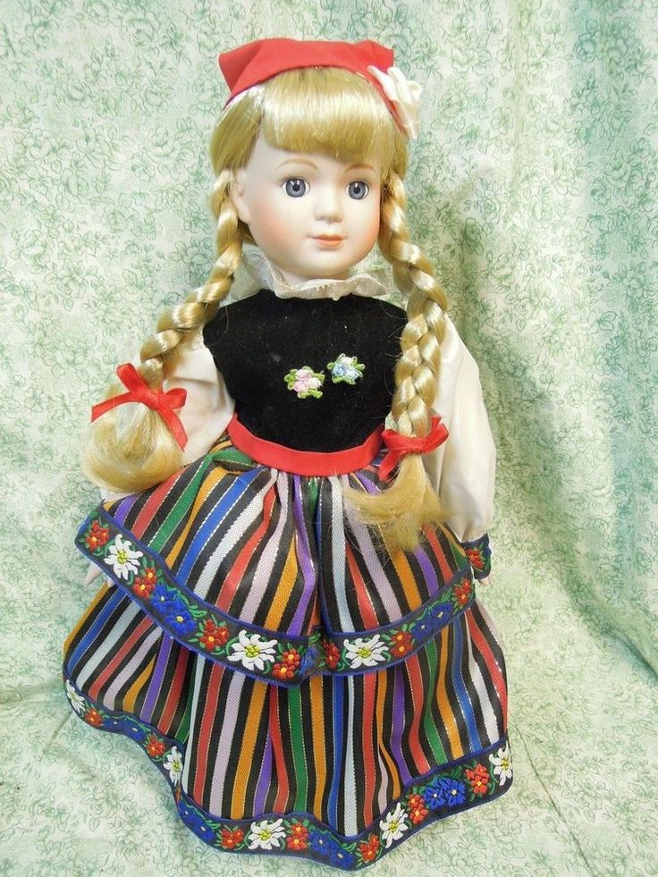 LC-584  Porcelain/cloth doll: Ethnic doll w/blonde hair - European costume; 16""