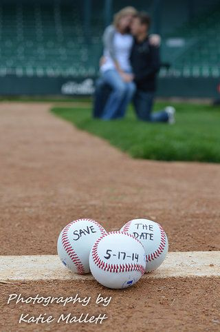 Save the Date ideas on the baseball diamond. We put baseballs on the pitcher mound that say the date of their wedding.  This was a home run for a fall engagement photo session. For more cute engagement photo prop ideas go to http://katiemallett.wix.com/katiesphotography-  Weddings/ Engagement