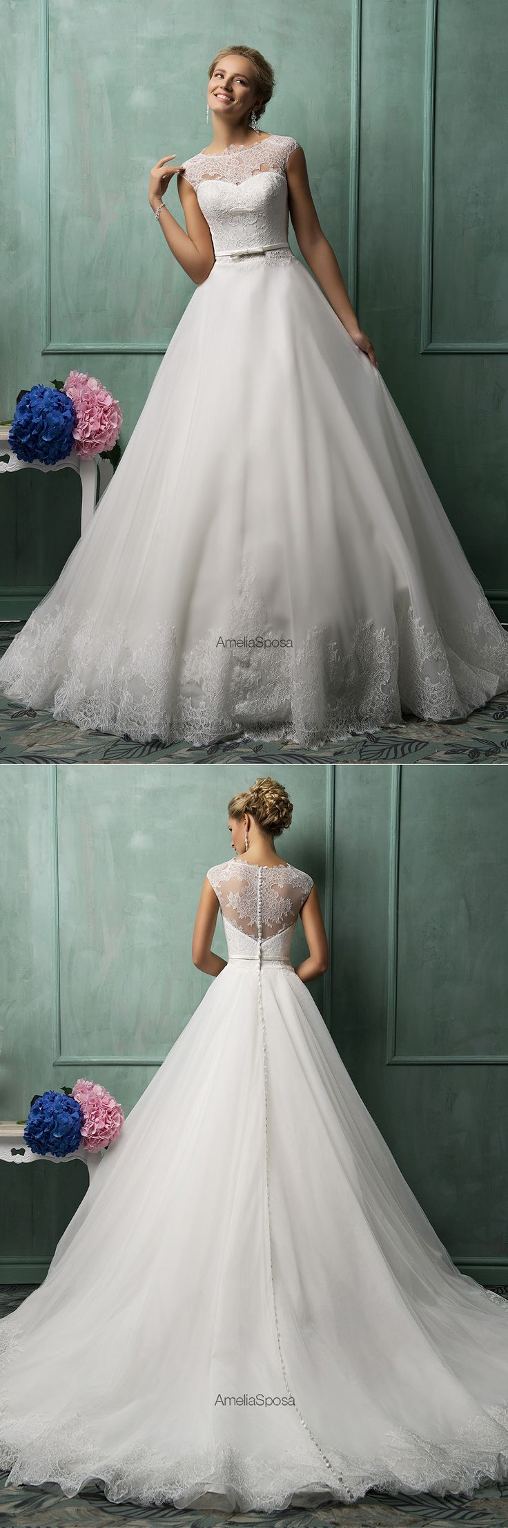 Amelia Sposa Davia Dress Tiny lace cap sleeves with a lace bodice that fall into a ballgown with lace detail at the bottom. #weddingdress #lacesleeves