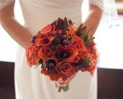 belli fiori, belli fiori florist, belli fiori wedding, bellifioristl, fall bouquets, fall bouquet, brown hypericum bouquet, coxcomb bouquets, orange coxcomb bouquet, red leucondendron bouquet, leonides rose bouquets, Jodi schlosser photography, four seasons st louis, st Louis four season, st louis weddings, stl weddings, saint louis wedding, st louis wedding flowers, bridesmaid bouquets, bridal bouquet, round bridesmaids bouquets, brown bridesmaids dresses,