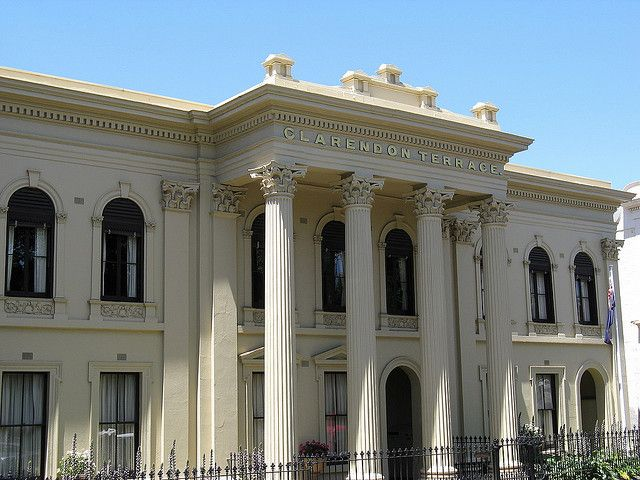 Clarendon Terrace in East Melbourne, was constructed as a set of three two-storey houses in the Victorian Free Classical style. Completed in 1857, the main feature of the building, which is made from blue stone with a cement rendered facade, is its central giant order portico with Corinthian columns.