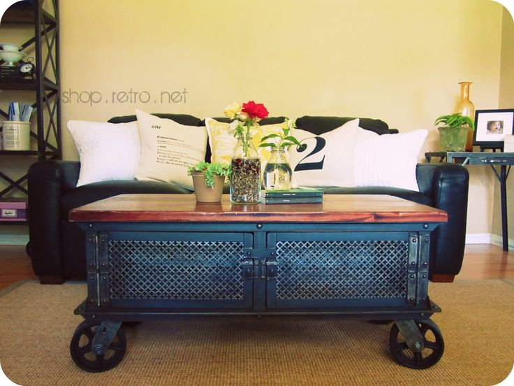 LOVE this vintage table on wheels, would look great in our living room